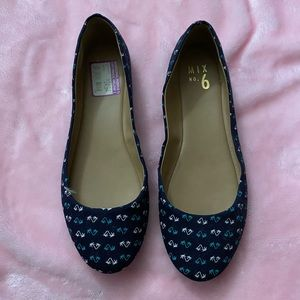 Navy flats with palm trees